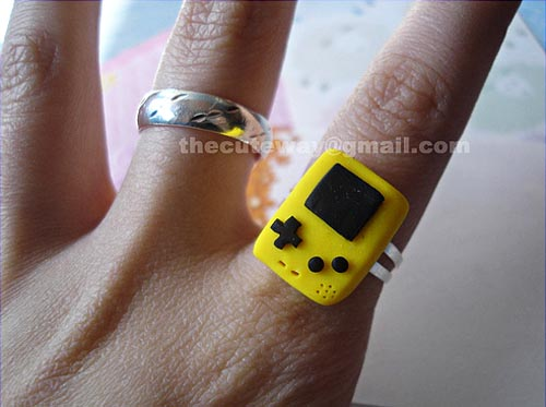 Tiny yellow Gameboy ring