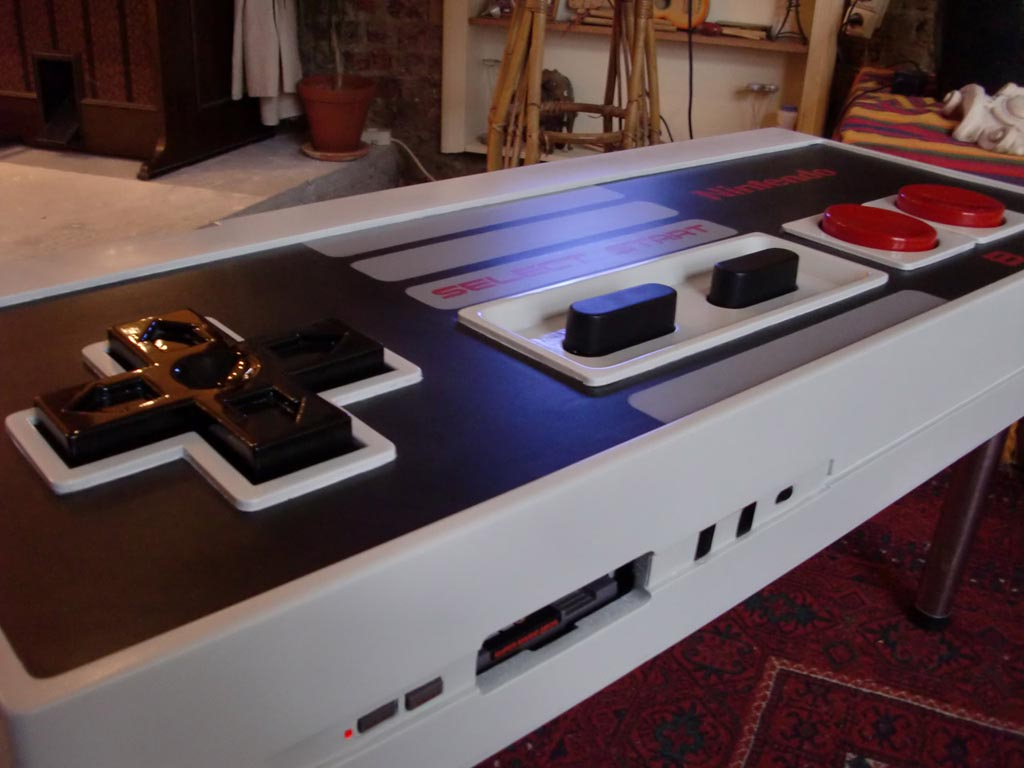 Nintendo nes controller coffee table integrated nes game console gadgetsin Console coffee table