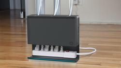 Plug Hub Organizes the Tangled Cables under Computer Desk