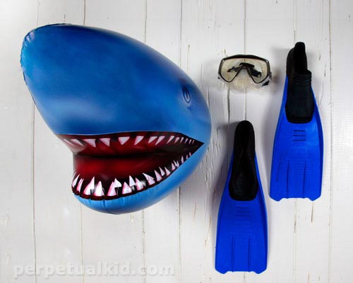 Show Your Inflatable Shark Head in the Swimming Pool