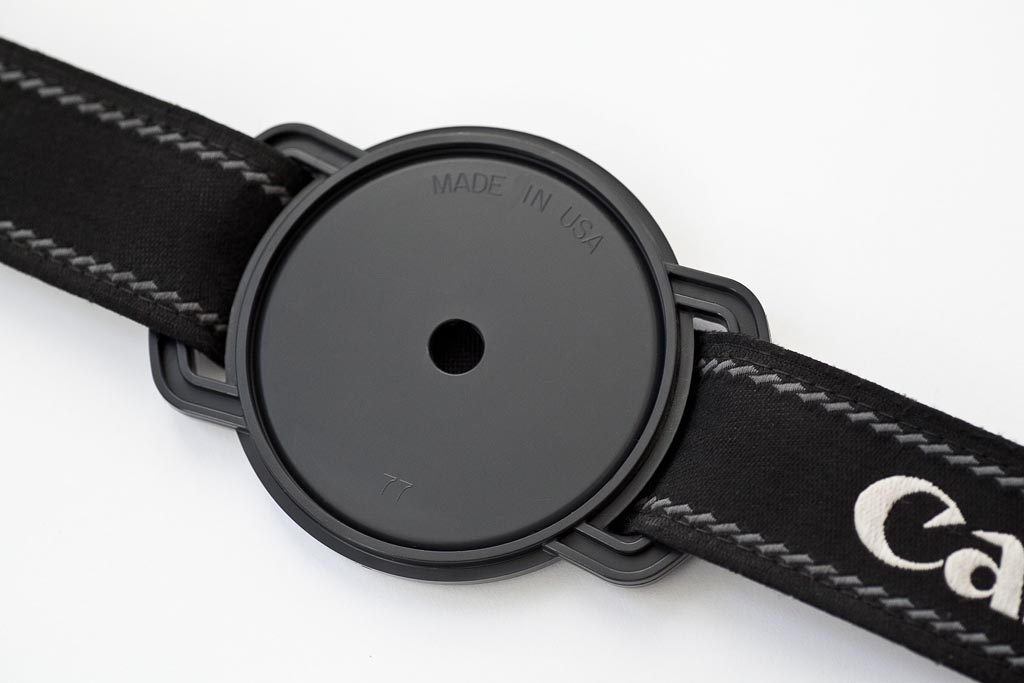 Camera cap holder
