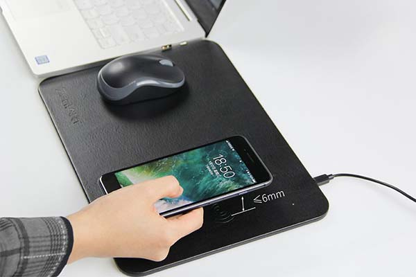 The Mouse Pad Features Integrated Wireless Charging Pad ...