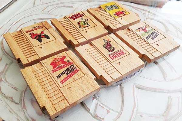 Handmade NES Cartridge Wooden Coaster Set with Colored 8-Bit Design